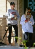 Hailey Bieber grabs a bite to eat with a friend at Freds Beverly Hills restaurant in Beverly Hills, Los Angeles