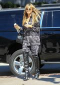 Heidi Klum dons a stylish patterned ensemble as she arrives at America's Got Talent Finals in Pasadena, California
