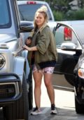 Hilary Duff rocks olive green jacket and floral print shorts for her morning coffee run in Studio City, Los Angeles