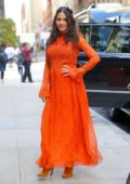 Jenna Dewan looks radiant in a bright orange dress while out in New York City
