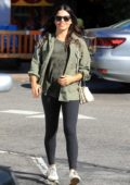Jenna Dewan shows off her baby bump in a camouflage top and leggings while running errands in Beverly Hills, Los Angeles