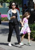 Jenna Dewan wears a black jumpsuit as she takes her daughter for shopping before movies at The Grove in Los Angeles