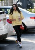 Jenna Dewan wears a yellow hoodie and black leggings as she takes her daughter to Dunkin Donuts in Encino, California