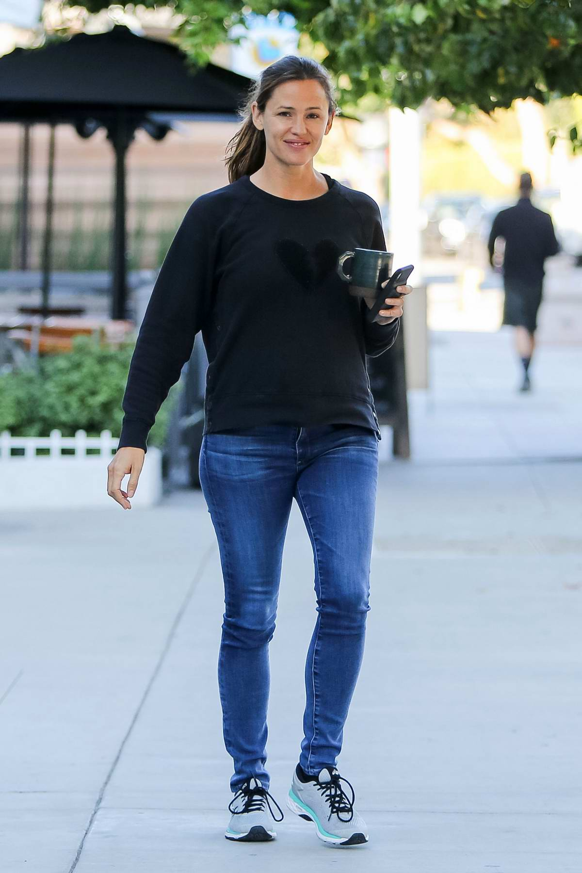 Jennifer Garner wears a black sweatshirt and jeans while out for a coffee in Los Angeles