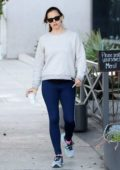 Jennifer Garner wears a grey sweatshirt and blue leggings as she steps out for a coffee at Blue Bottle Cafe in Brentwood, Los Angeles