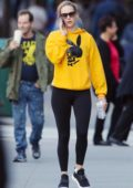 Jennifer Lawrence rocks a bright yellow hoodie and black leggings while heading to the gym in New York City