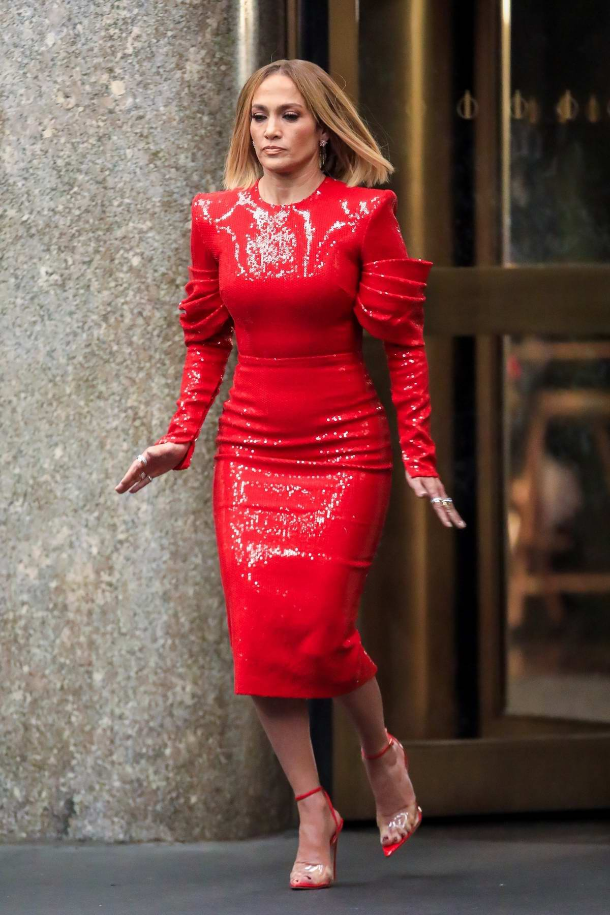 Jennifer Lopez seen wearing a bright red dress while filming 'Marry Me' at Rockefeller Plaza in New York City