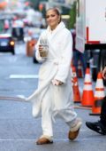 Jennifer Lopez seen wearing white bathrobe with a pair of UGG slippers while on the set of 'Marry Me' in New York City
