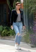 Jessica Biel wears black leather jacket, striped top and jeans during a lunch outing with friends in Los Angeles