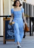 Joey King looks cute in a baby blue jumpsuit while picking up a to-go order from a seafood restaurant in Studio City, Los Angeles