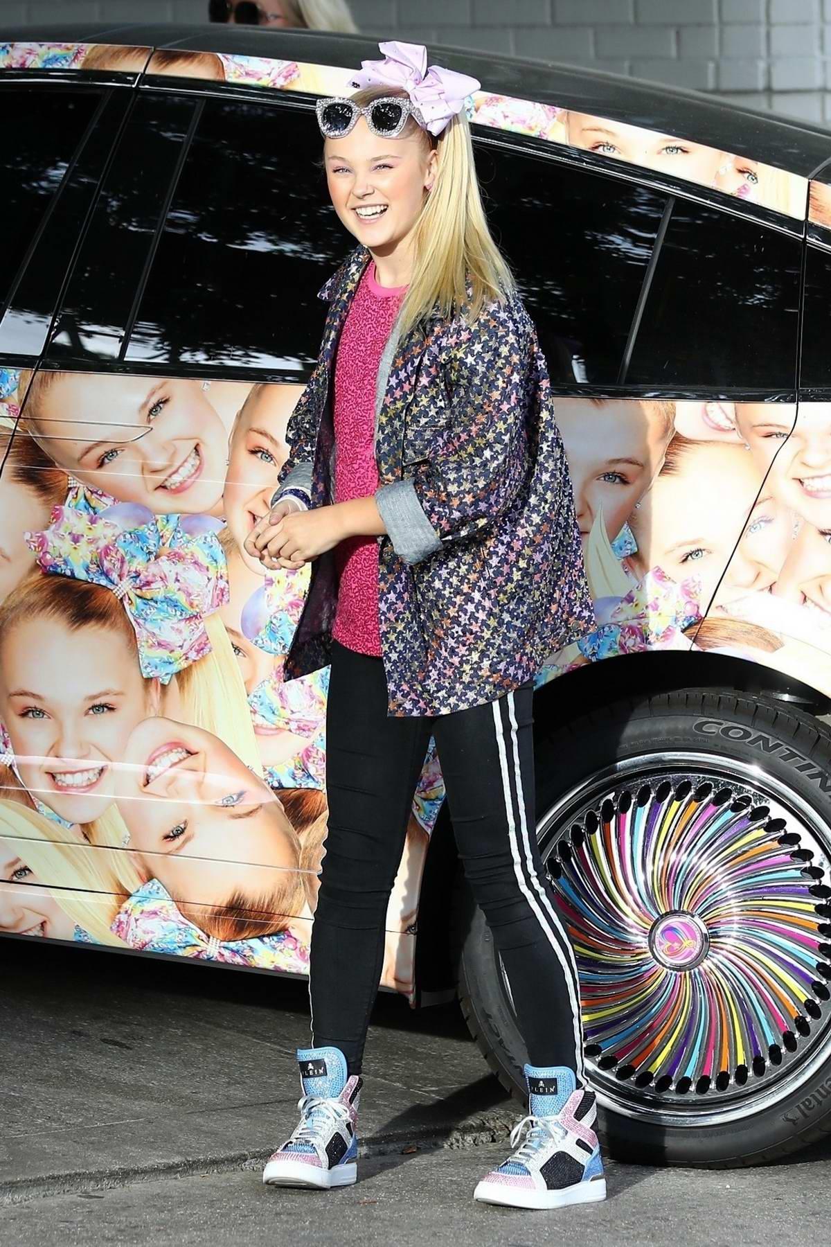 JoJo Siwa seen with her custom wrapped Tesla Model X in Los Angeles