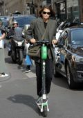 Kaia Gerber seen riding around the streets on a scooter in Paris, France
