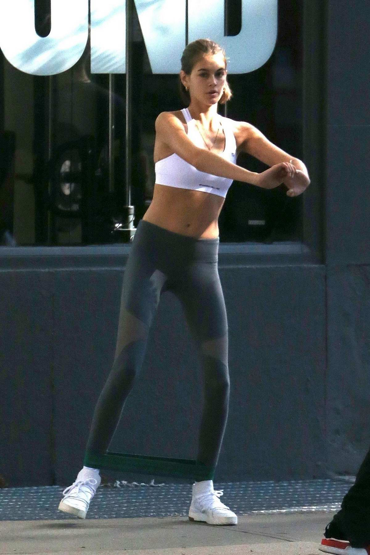 Kaia Gerber shows off her slender physique in a sports bra and leggings during a workout session at The Dogpound Gym in New York City
