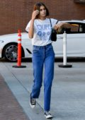 Kaia Gerber wears a vintage 'Queen' tee, jeans and converse while visiting a Medical building in Beverly Hills, Los Angeles