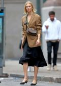 Karlie Kloss looks fashionable in brown blazer over a black dress while out in New York City