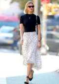 Karlie Kloss looks lovely in a black top paired with a Stella McCartney skirt and Celine bag while stepping out in New York City