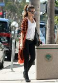 Kate Beckinsale wears an animal print cardigan paired with a white tank top, jeans and high heel boots while out in Los Angeles