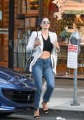 Katharine McPhee flashes her toned abs in a black crop during a shopping outing in Los Angeles