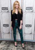 Katherine McNamara looks stylish in black blazer and green pvc pants while visiting Build Series in New York City