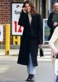 Katie Holmes is all smiles while talking on her phone during a stroll in New York City