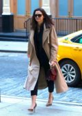 Katie Holmes keeps it stylish in a black ensemble paired with a beige trench coat as she arrives at the Crosby Hotel in New York City