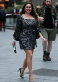 Kelly Brook stuns in a sparkling silver mini dress as she attends Global's 'Make Some Noise' in London, UK