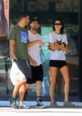 Kendall Jenner dressed casually in a white tee and black short shorts during a trip to Petco in West Hollywood, Los Angeles