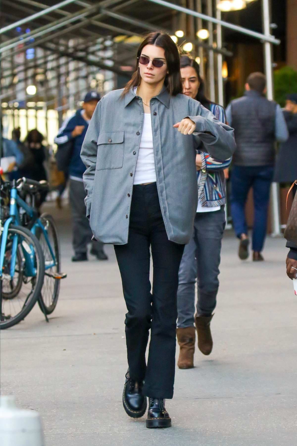 Kendall Jenner keeps it stylish in a work jacket paired with a white top and black pants as she steps out in New York City