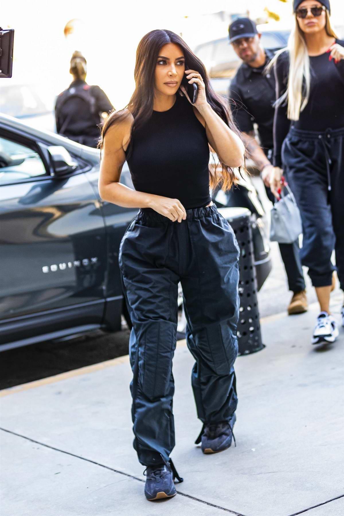 Kim Kardashian and Khloe Kardashian wear matching black attire as they visit Cryohealthcare Medical Center in Los Angeles