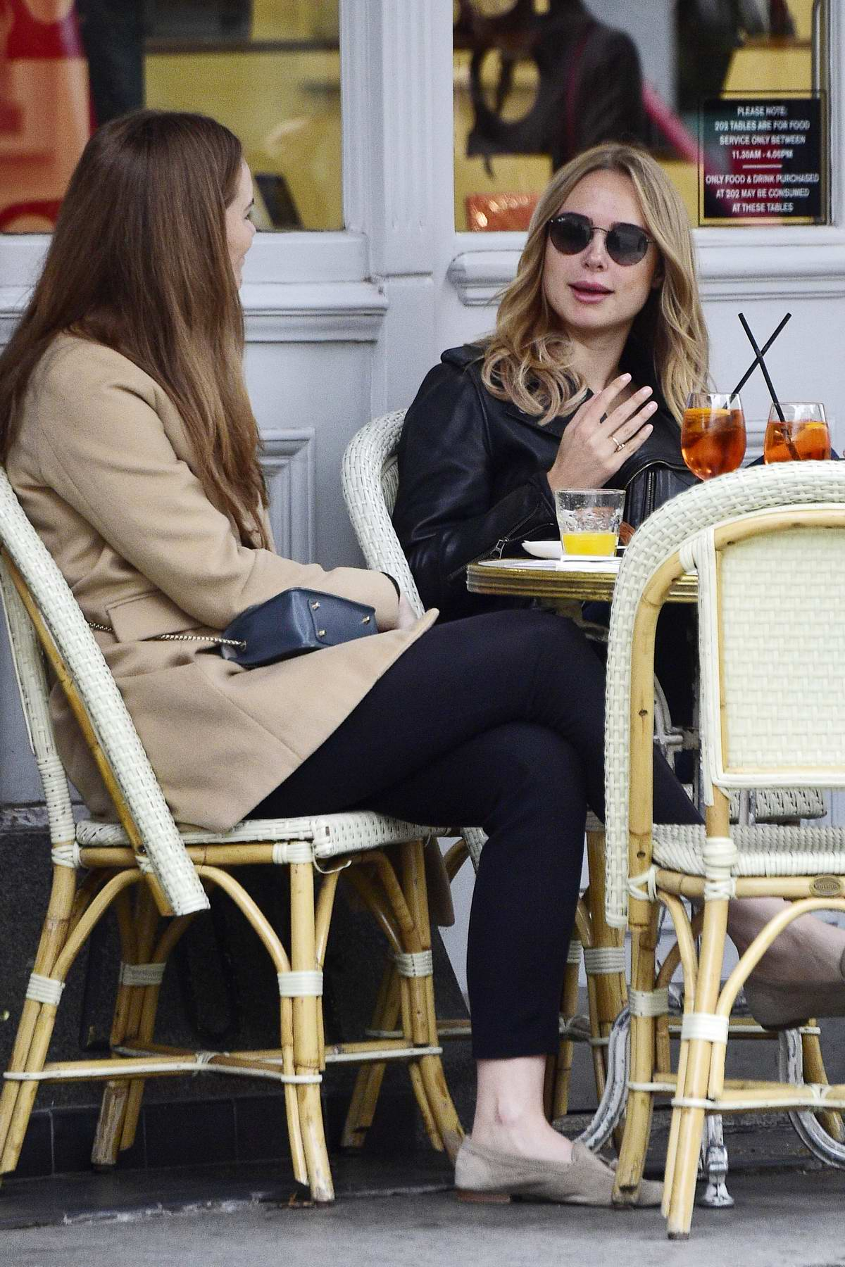 Kimberley Garner enjoys a spritzer and lunch with Ellie Lyons in West London, UK