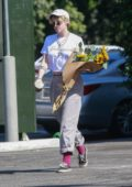 Kristen Stewart spotted with a large bouquet of Sunflowers while out in Los Angeles