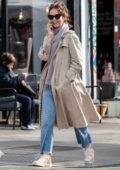 Lily James looks pretty in Burberry trench coat and monogrammed Burberry scarf as she steps out in London, UK