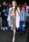 Lindsay Lohan dazzles in a metallic silver dress as she heads out of the Mercer Hotel in New York City