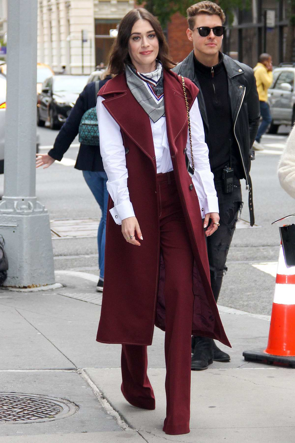 Lizzy Caplan looks great in a maroon and white ensemble while visiting Build Speaker Series in New York City
