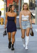 Lottie Moss rocks a white crop top with denim mini skirt and knee high white boots while out with a friend in Beverly Hills, Los Angeles
