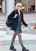 Lucy Boynton is all smiles as she arrives at LAX Airport in Los Angeles