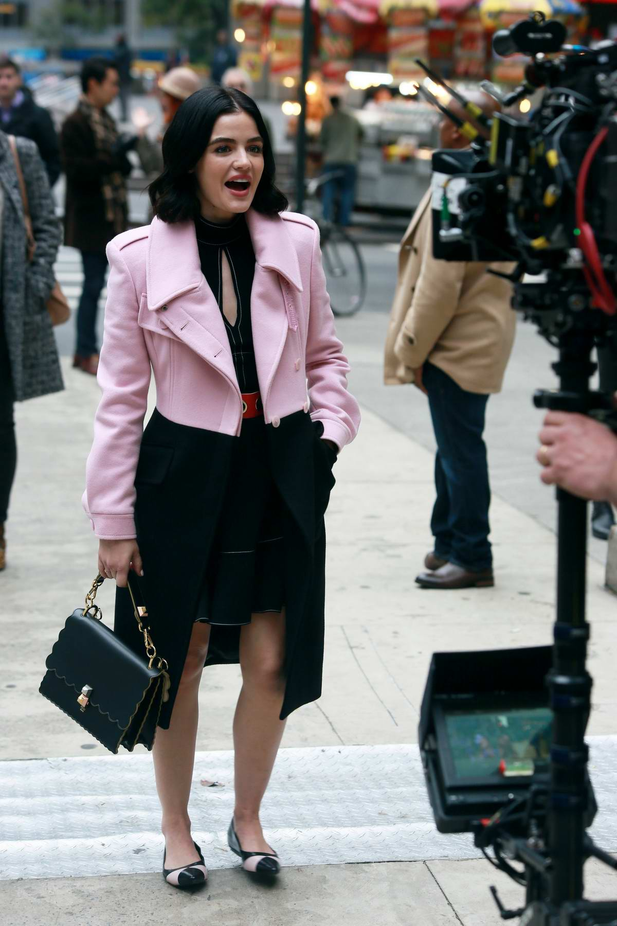 Lucy Hale looks all decked up in pink jacket over a black dress while on the set of 'Katy Keene' in New York City