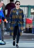 Lucy Hale looks comfy in a plaid wool coat with black leggings while out on a morning stroll in New York City