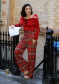 Lucy Hale spotted in a red top and plaid pants while filming 'Katy Keene' in Brooklyn, New York City