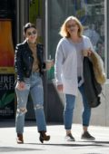 Lucy Hale wears a black leather jacket and ripped jeans as she steps out with her mother in New York City