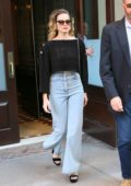 Margot Robbie looks great in a Chanel crop top and jeans as she leaves her hotel in New York City