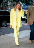 Margot Robbie stuns in a bright yellow suit as she steps out in New York City