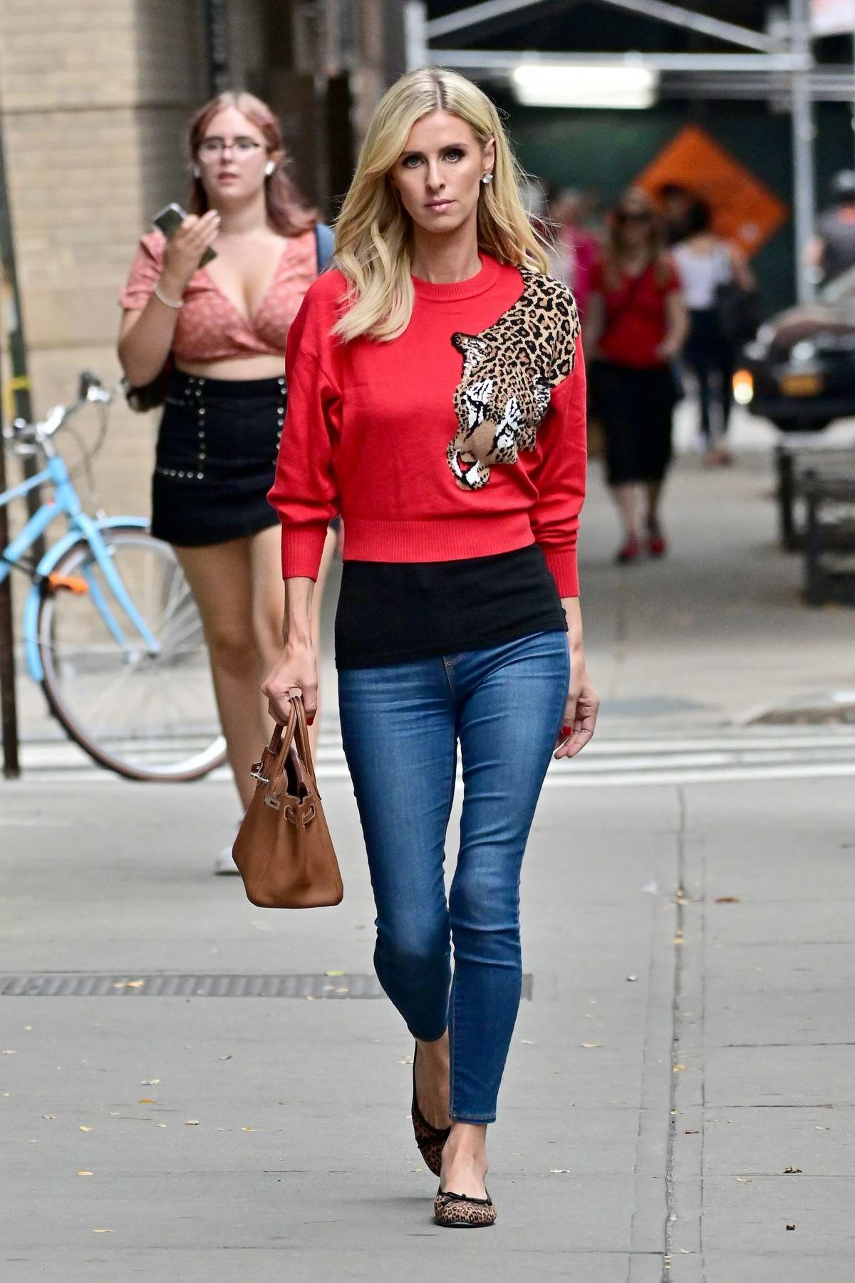 Nicky Hilton looks stylish in a cheetah style red sweater and jeans while out in New York City