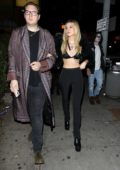 Nicola Peltz flashes her toned midriff as she leaves Drake's Birthday Party at 'Delilah' in West Hollywood, Los Angeles