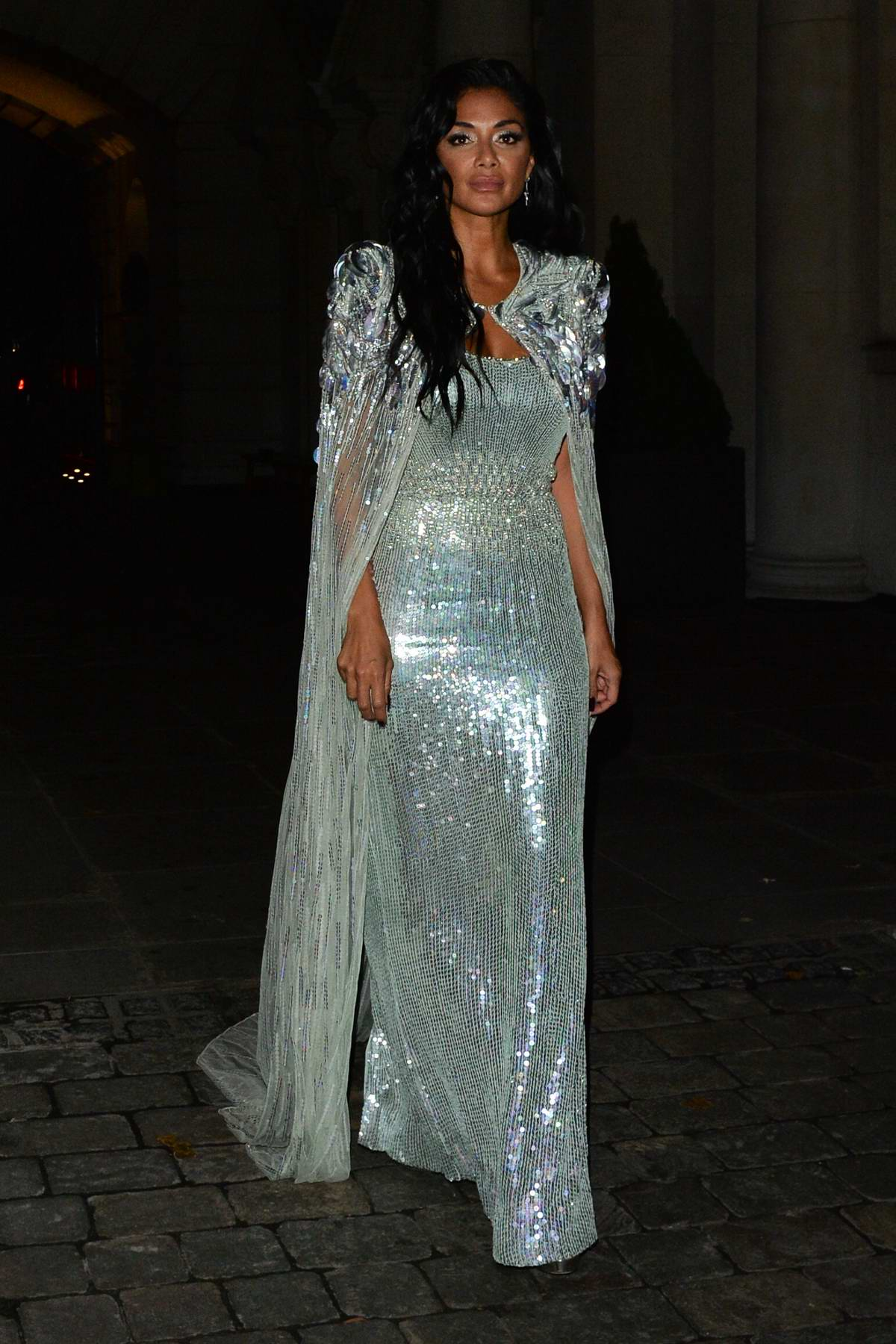 Nicole Scherzinger seen wearing a shimmery blue dress during a night out in Mayfair, London, UK