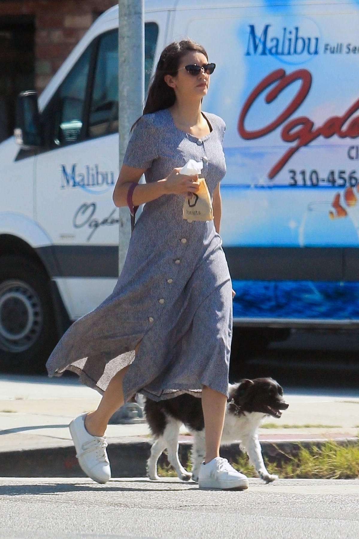 Nina Dobrev keeps it casual in a buttoned down dress during a coffee run with her dog in Hollywood, California