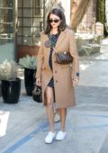 Nina Dobrev looks cute in a polka dot dress paired with a brown trench coat as she leaves Nine Zero One salon in Los Angeles