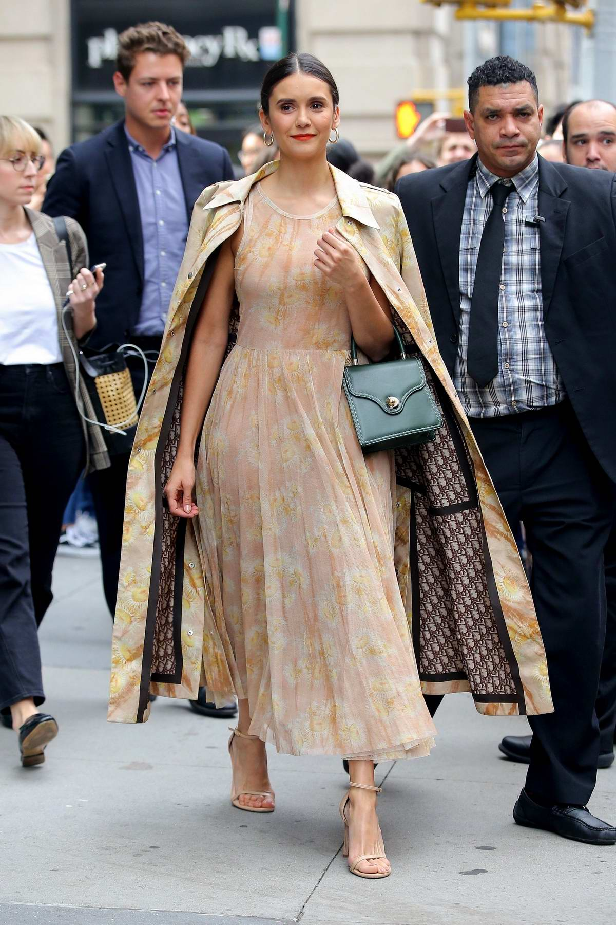 Nina Dobrev looks gorgeous in a beige floral print dress while visiting the Build Series in New York City