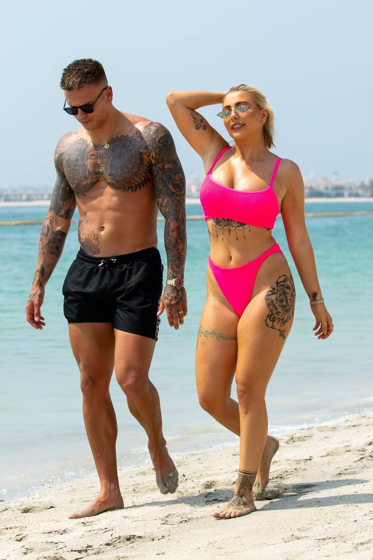 Olivia Buckland wears a hot pink bikini as she hits the beach with Alex Bowen in Dubai, UAE