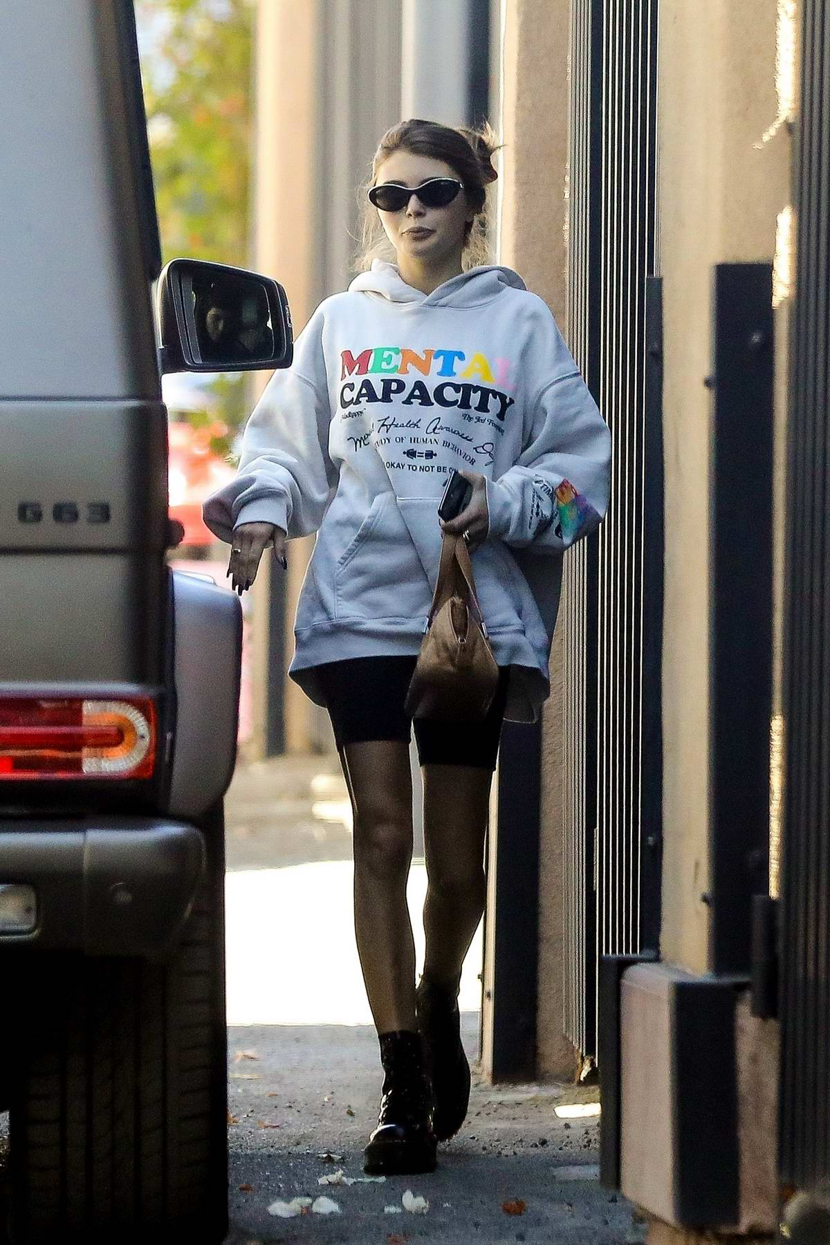 Olivia Jade Giannulli wears a hoodie and bike shorts while out for brunch with sister Isabella Rose in Beverly Hills, Los Angeles